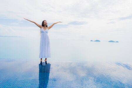 Portrait young asian woman relax smile happy around swimming pool in hotel and resort for holiday vacation travel concept Zdjęcie Seryjne - 130026914