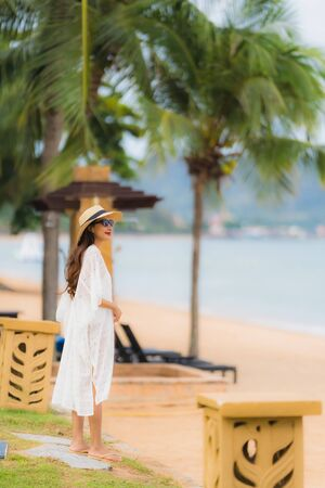 Portrait beautiful young asian woman smile happy relax on the beach sea ocean in holiday vacation travel