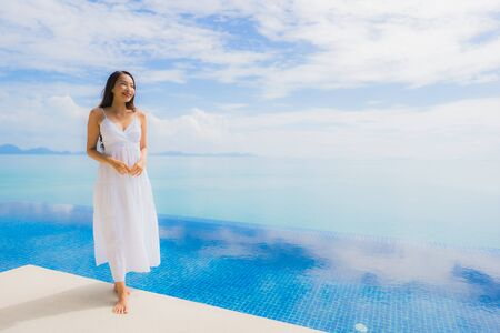 Portrait young asian woman relax smile happy around swimming pool in hotel and resort for holiday vacation travel concept Zdjęcie Seryjne - 130027049