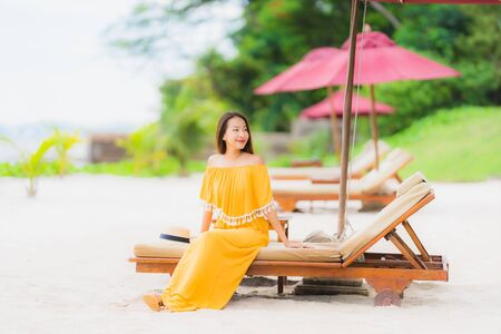 Portrait beautiful asian woman wear hat with smile happy leisure on the beach sea ocean in holiday vacation concept
