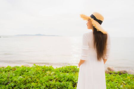 Portrait beautiful asian woman wear hat with smile happy leisure on the beach and sea ocean in holiday vacation Stock fotó