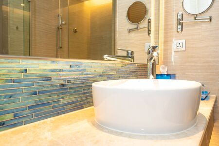 Water faucet tap and white sink decoration in bathroom interior of room