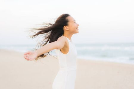 Portrait beautiful young asian woman happy and smile on the beach sea and ocean for travel and vacation