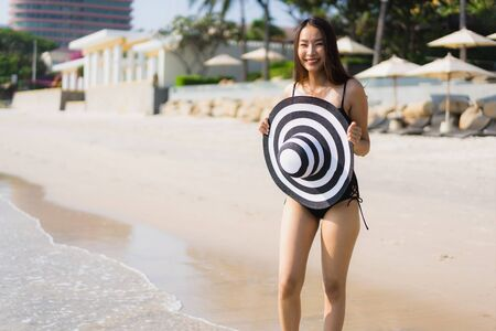 Portrait beautiful young asian woman happy and smile on the beach and sea for travel and vacation concept Stock fotó
