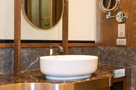 Sink and water tap faucet decoration in bathroom interior