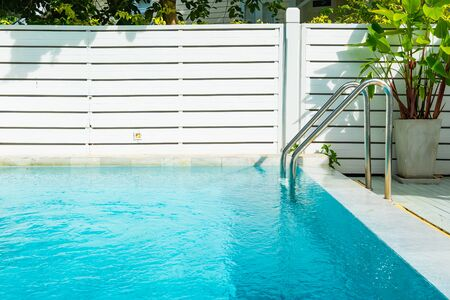 Beautiful outdoor swimming pool in hotel resort with stair for leisure relax in holiday vacation