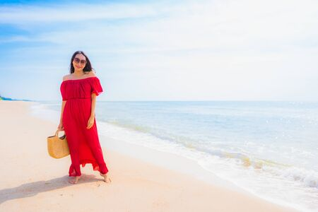 Portrait beautiful young asian woman smile with happy and walk on the beach and sea for leisure holiday vacation concept Stock fotó