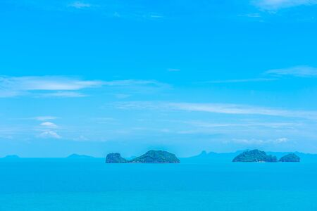 Beautiful outdoor sea ocean view with island and white cloud on blue sky for holiday vacation travel background