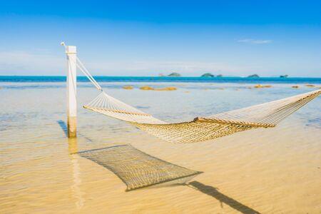 Beautiful empty hammock around tropical beach sea ocean for holiday vacation concept