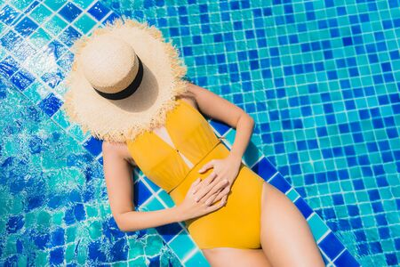 Portrait beautiful young asian woman leisure relax smile and happy around swimming pool in hotel resort for holiday vacation trip Stock fotó