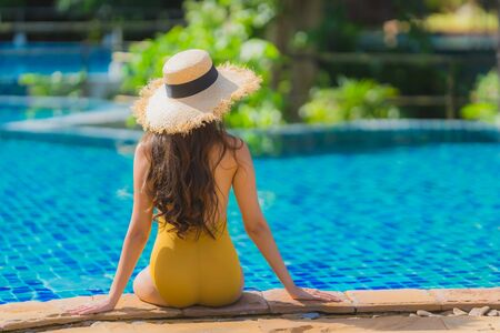 Portrait beautiful young asian woman leisure relax smile and happy around swimming pool in hotel resort for holiday vacation trip Фото со стока