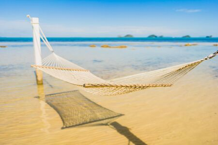 Beautiful empty hammock around tropical beach sea ocean for holiday vacation concept