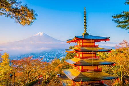 Beautiful landscape of mountain fuji with chureito pagoda around maple leaf tree in autumn season at Yamanashi Japan Imagens