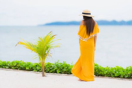 Portrait beautiful asian woman wear hat with smile happy leisure on the beach and sea ocean in holiday vacation Imagens