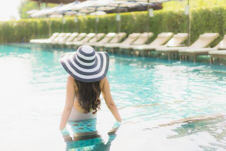 Portrait beautiful asian women happy smile relax around swimming pool in hotel resort for holiday vacation