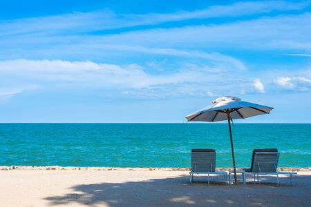 Beautiful umbrella and chair around beach sea ocean with blue sky for travel vacation