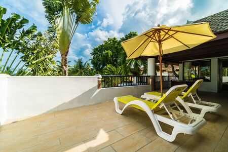 Umbrella and chair on outdoor patio with beautiful view for travel and vacation