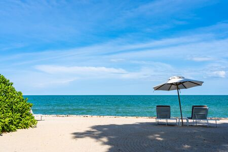 Beautiful umbrella and chair around beach sea ocean with blue sky for travel vacation Фото со стока - 131349809