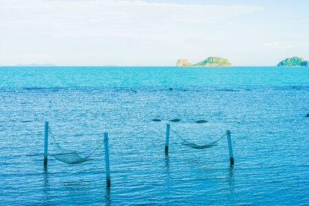 Empty hammock around beautiful beach sea ocean for relax in holiday vacation travel concept Фото со стока
