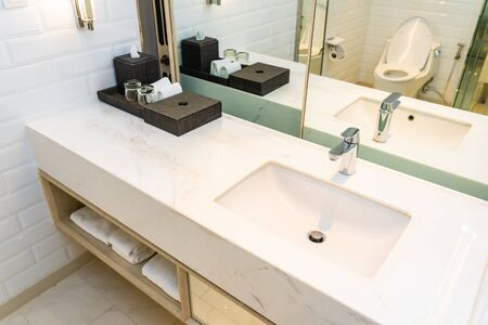Faucet water and sink decoration in bathroom and toilet interior Фото со стока