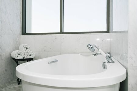 Beautiful luxury white and clean bathtub decoration in bathroom interior
