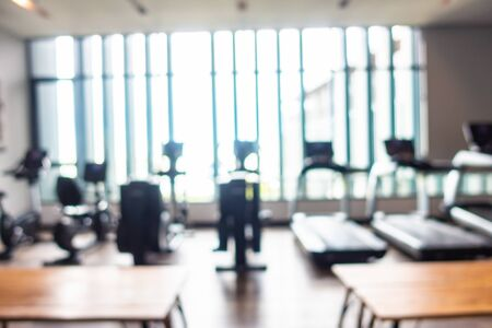 Abstract blur and defocus fitness equipment in gym room interior