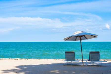 Beautiful umbrella and chair around beach sea ocean with blue sky for travel vacation Фото со стока - 131349447