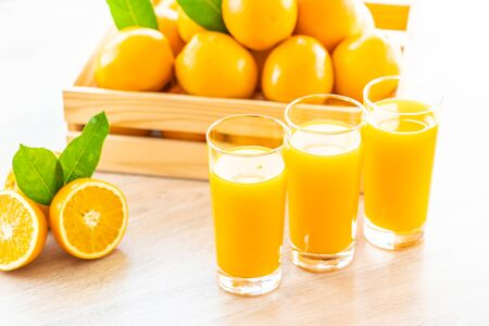 Fresh orange juice for drink in glass on wooden table - Healthy food concept Фото со стока - 131349587