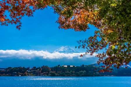 Beautiful landscape of mountain fuji with maple leaf tree around lake in autumn season Stock fotó