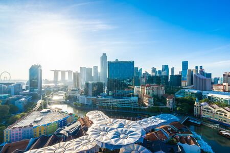 Beautiful architecture building exterior cityscape in Singapore city skyline with white cloud on blue sky Фото со стока - 131350727