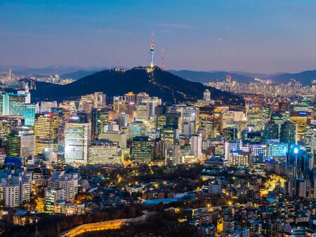 Beautiful Architecture building cityscape with tower in Seoul city South Korea Фото со стока