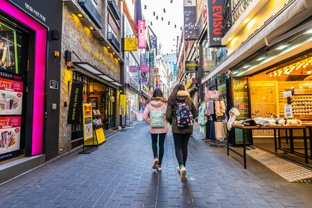 Seoul, South Korea 10 December 2018 : Myeong dong market is the popular place and district for shopping find something eat and sightseeing Фото со стока - 131351038