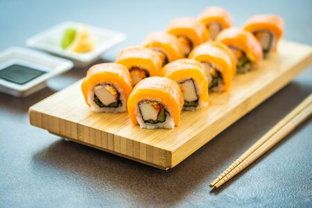 Salmon fish meat sushi roll maki on wood plate with wasabi and soy sauce - Japanese food style Reklamní fotografie