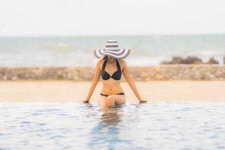 Portrait beautiful young asian woman wear bikini around swimming pool