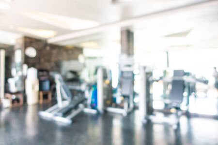 Abstract blur and defocus fitness equipment in gym room interior for exercise Stock Photo