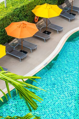 Beautiful outdoor swimming pool in hotel resort for holiday vacation concept Stock Photo