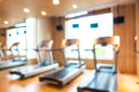 Abstract blur and defocus fitness equipment in gym room interior Standard-Bild