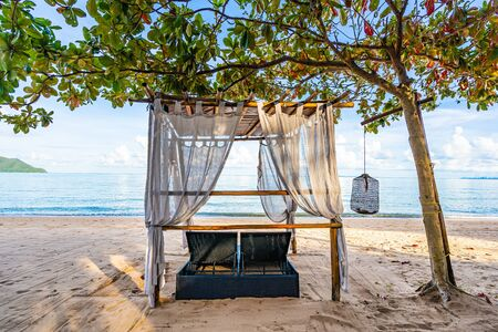 Empty bed chair and lounge on the tropical beach sea ocean with white cloud on blue sky for leisure travel and in holiday vacation