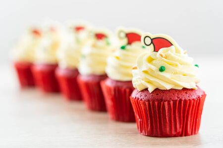 Sweet dessert with cupcake red velvet and chocolate christmas hat on top