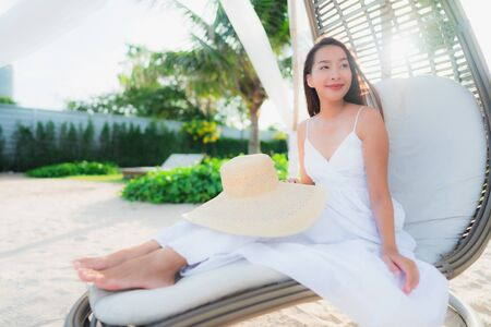 Portrait beautiful asian women around beach sea ocean with happy smile in holiday vacation