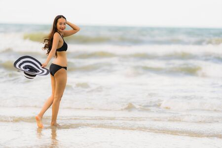 Portrait beautiful young asian woman wear bikini on the beach sea ocean for leisure relax in holiday vacation time Stockfoto