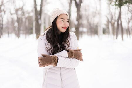 Beautiful young asian woman smiling happy with travel in snow winter season at Hokkaido Japan Stok Fotoğraf