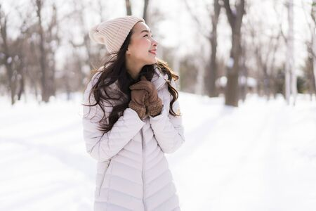 Beautiful young asian woman smiling happy with travel in snow winter season at Hokkaido Japan Stok Fotoğraf - 132011959