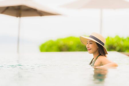 Portrait beautiful young asian woman relax in luxury outdoor swimming pool in hotel resort nearly beach sea ocean for holiday vacation concept Reklamní fotografie - 132071463