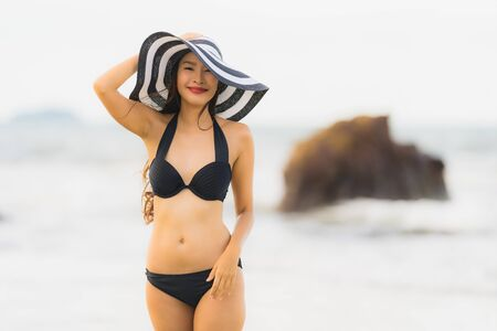 Portrait beautiful young asian woman wear bikini on the beach sea ocean for leisure relax in holiday vacatiom time Reklamní fotografie - 132071491