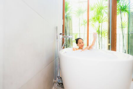 Portrait young beautiful asian woman take a bath in bathtub for leisure relax and in bathroom interior Stock fotó - 133463245