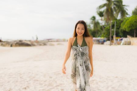 Portrait beautiful asian women happy smile relax on the tropical beach sea ocean in holiday vacation