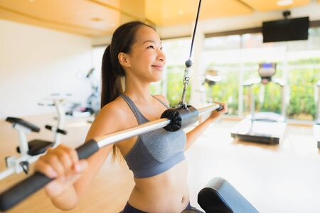 Portrait asian woman exercising workout and training in gym for healthy