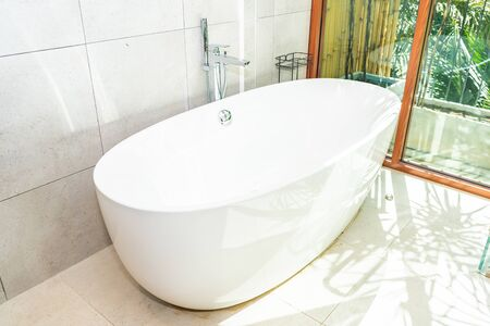 Beautiful White luxury bathtub decoration in bathroom interior Фото со стока