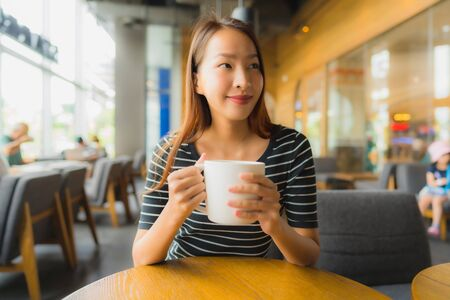 Portrait beautiful young asian women in coffee shop cafe and restaurant using mobile phone